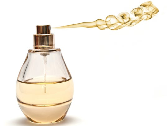 Yellow Spraying Parfume on White Background
