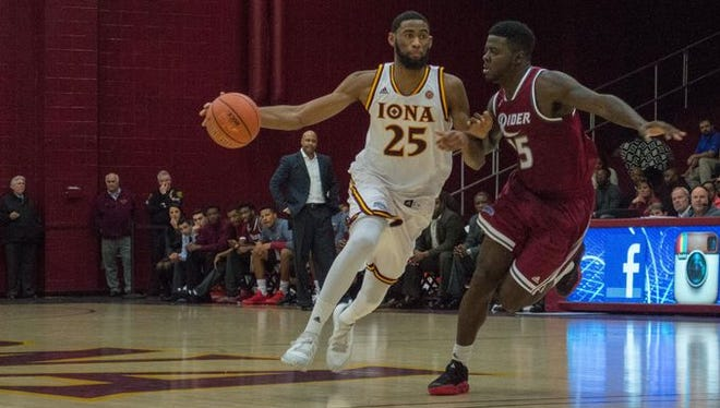 Iona's Aaron Rountree moves up the court against Rider's Lacey James during the second half of a MAAC Conference men's basketball game between Iona and Rider on Jan. 7, 2016.