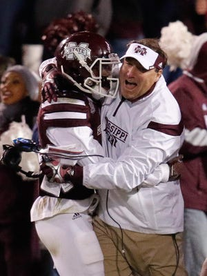 Nov 1, 2014; Starkville, MS, USA; Mississippi State Bulldogs head coach Dan Mullen celebrates with defensive back Will Redmond (2) after Redmond intercepted a pass to seal the win against the Arkansas Razorbacks at Davis Wade Stadium.  The Bulldogs defeat the Razorbacks 17-10. Mandatory Credit: Marvin Gentry-USA TODAY Sports