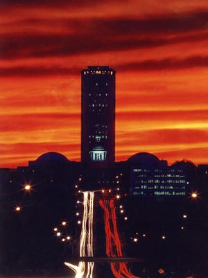 allahassee Democrat photographer Mike Ewen captured a colorful image of the Florida capitol in 1993, by shooting a time-lapse photo of Apalachee Parkway traffic at night.