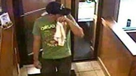"Surveillance footage showing the ""shirt mask bandit."""