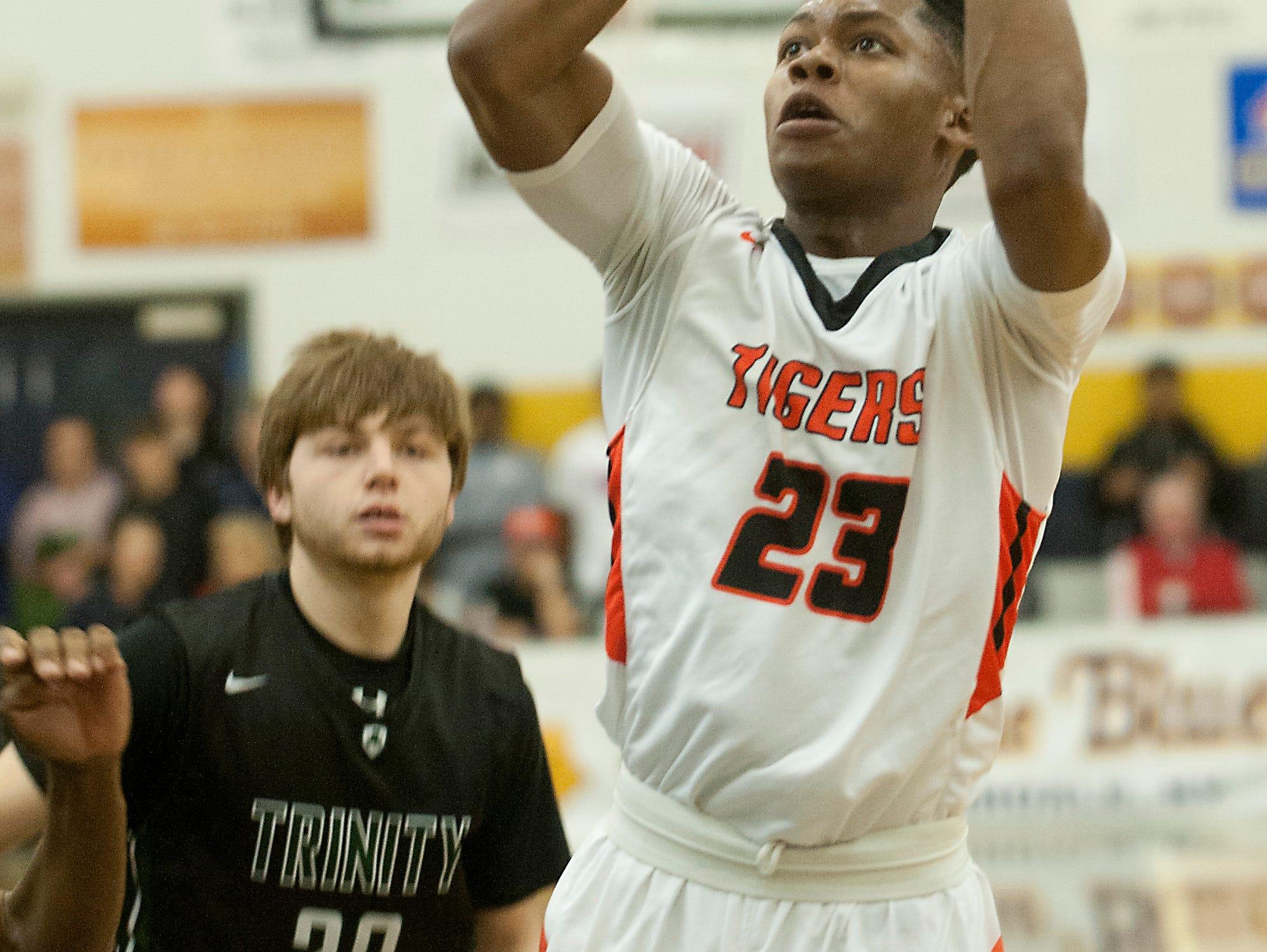 Fern Creek guard Tony Rogers beats Trinity guard Brendan King to the basket. 18 December 2016