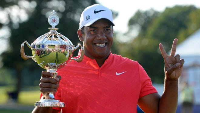 Jhonattan Vegas poses with the trophy after winning the RBC Canadian Open at Glen Abbey Golf Club in Oakville, Ontario.