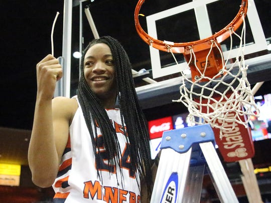 UTEP's Jenzel Nash cuts a piece of the net off the rim as the Miners celebrate their regular season C-USA title victory Saturday in the Don Haskins Center. The Miners defeated Charlotte 94-91 in double overtime.