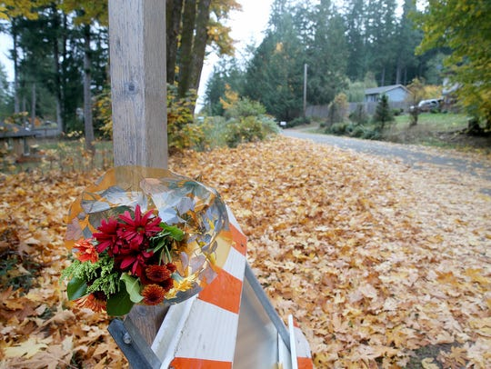 A bouquet of flowers at the end of Symes Road in Central Kitsap, where 9-year-old Ryan T. Rosales was killed early Tuesday.