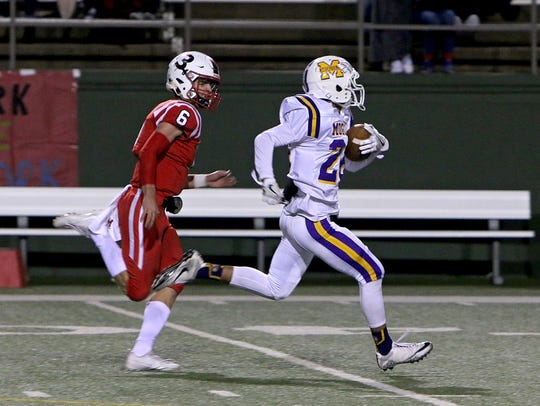 Munday's Brady Weaver (right) tries to outrun Muenster's