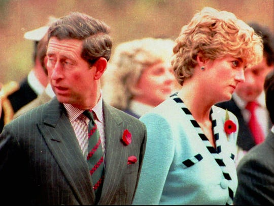 Britain's Prince and Princess of Wales look their separate ways during a memorial service on their tour of South Korea on Nov. 3, 1992. The royal couple announced their separation on Dec. 9 of that year.