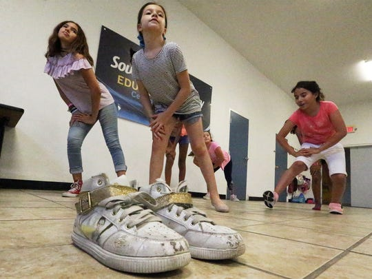 Sophia Morales, center, works on a dance routine July