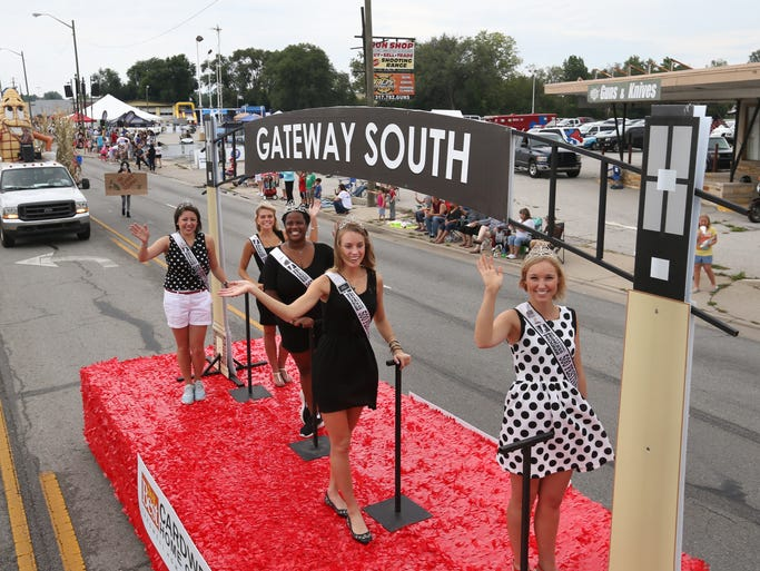 Some of the 500 Festival Princesses wave to the crowd as they ride the Cardwell Home Center float in the 8th Annual Miracle Mile Parade, the highlight of Southside Indianapolis' Gateway Fest on Saturday, August 30, 2014.
