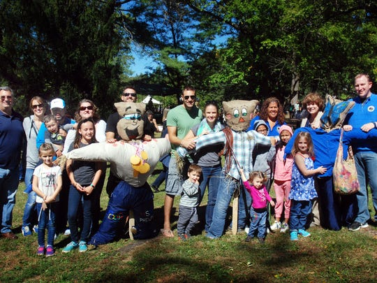 Union County Freeholders Linda Carter, Christopher Hudak, Bette Jane Kowalski and Alexander Mirabella congratulate the Kelly-Ebbe  family from Rahway/Scotch Plains, the Hudak family from Linden and the Salfi family from North Caldwell on winning the scarecrow contest at the 35th Annual Harvest Festival at Trailside Nature and Science Center in Mountainside.