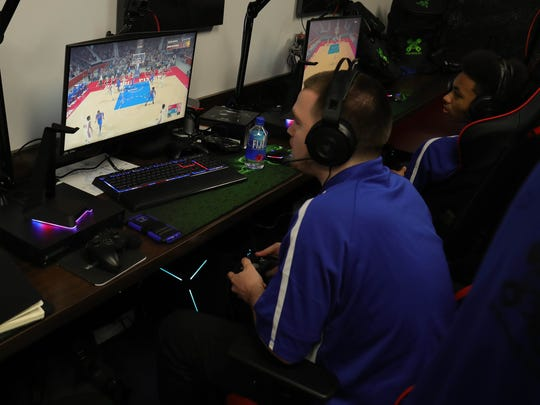 The Pistons NBA 2K team  Ramo Radoncic, left, and Rochell Woods practice in the gaming room they will use to compete with other 2K teams around the NBA Monday, April 24, 2018, at the Palace in Auburn Hills, Mich.