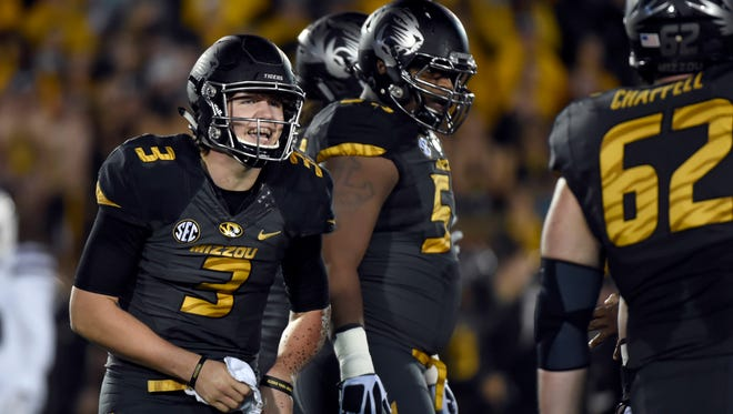In this Nov. 5, 2015, file photo, Missouri quarterback Drew Lock left, and teammates get ready to run a play during an NCAA college football game against Mississippi State in Columbia, Mo. Though only a sophomore, Lock has more experience than the majority of the quarterbacks in the Southeastern Conference. Only four quarterbacks in the conference have made more starts than Lock, all of whom are older.