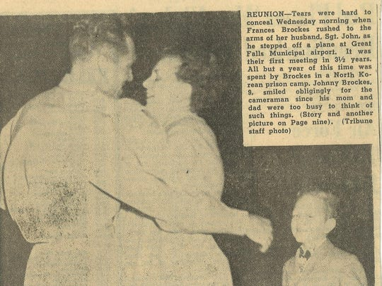 John Brockes greets his wife in this newspaper clipping.