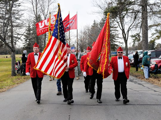Area Veterans groups march in the Veterans Day Parade at the St. Cloud VA Health Care System grounds.