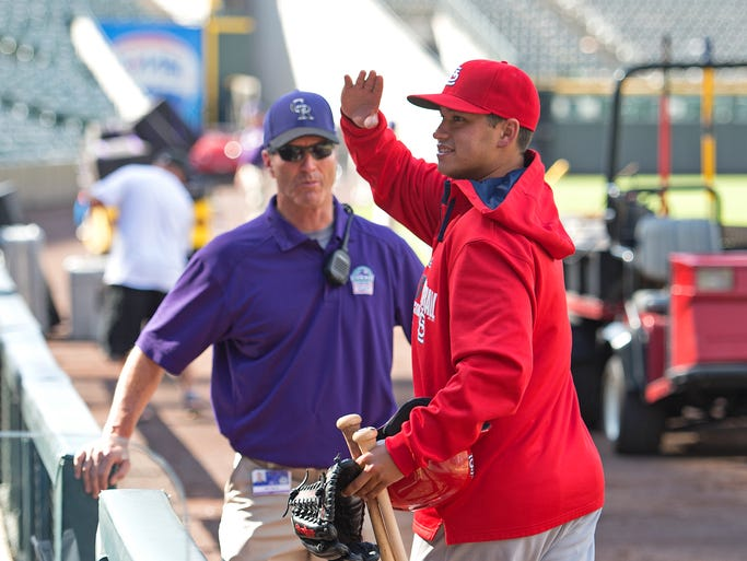 Marco Gonzales, former Rocky Mountain High School pitcher, waves to friends and family after he made his Major League Baseball debut for the St. Louis Cardinals against the Colorado Rockies at Coors Field in Denver Wednesday, June 25, 2014. The Cardinals beat the Rockies 9-6.