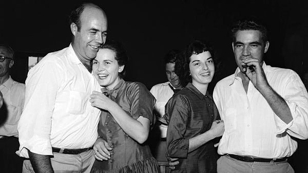 J.W. Milam and Roy Bryant celebrate their acquittal by an all-white jury. Months later, they admitted to Look magazine they had indeed killed Emmett Till.