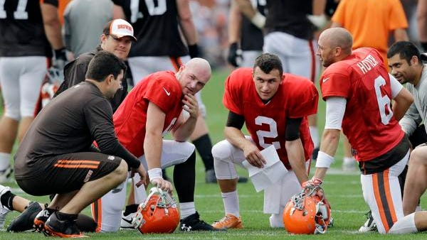 Rex Grossman, left, talks with Cleveland Browns quarterbacks Connor Shaw, Johnny Manziel (2) and Brian Hoyer (6) during practice at training camp in Berea, Ohio, Tuesday, Aug. 12, 2014.