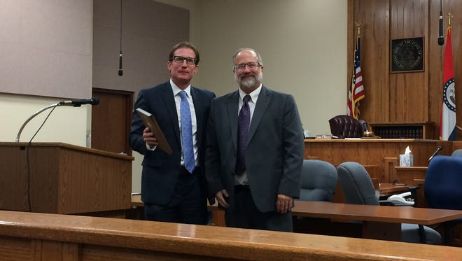 Juvenile Court Administrator Bill Prince, left, of the 31st Judicial Circuit accepts an award presented by Missouri Supreme Court Judge W. Brent Powell on July 19.