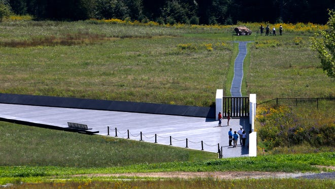 This is the view of the crash site of United Airlines Flight 93, marked by the boulder, right rear, from the observation deck of the Flight 93 National Memorial visitors center in Shanksville, Pa, pictured in September 2015.