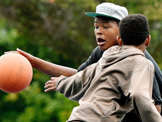 Despite some drizzle, Rubin Elliott, 17, back, and Dorian Whitted, 15, both of York City, play basketball Wednesday at Penn Park. York County could get a substantial amount of rain this weekend, depending on how Hurricane Joaquin tracks.