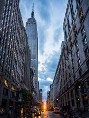 Clearing skies allowed the sun to come through with a dramatic sunset during a past Manhattanhenge.