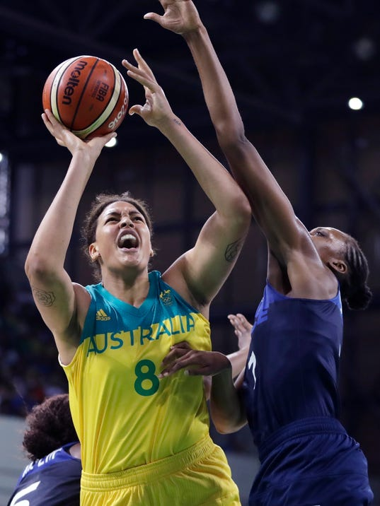 FILE - In this Tuesday, Aug. 9, 2016 file photo, Australia center Liz Cambage (8) shoots over France center Sandrine Gruda during the second half of a women's basketball game at the Youth Center at the 2016 Summer Olympics in Rio de Janeiro, Brazil. Australian center Liz Cambage has signed a multiyear contract with the Dallas Wings, returning to the WNBA organization that drafted her second overall seven years ago. In announcing the deal Monday, Feb. 5, 2018, Wings president Greg Bibb called the 6-foot-8 Cambage one of the best players in the world. (AP Photo/Carlos Osorio, File)