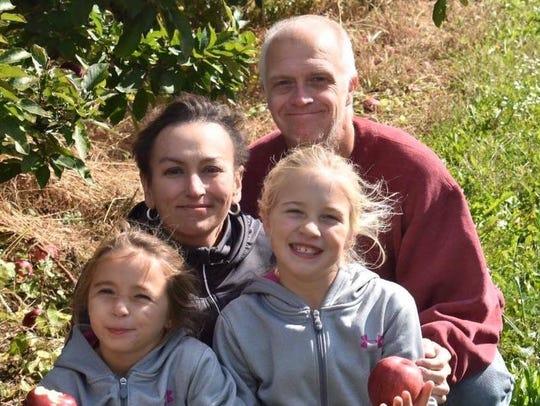 Heather Davis Johnson and her family enjoying apple-picking