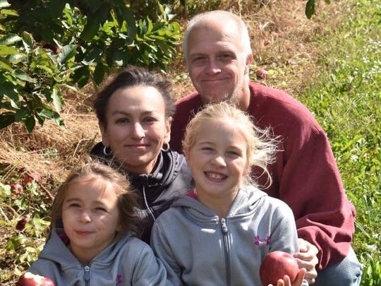 Heather Davis Johnson and her family enjoy an apple-picking outing.