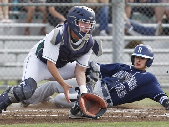 Redwood's Chris Gonzalez slides past El Diamante's Connor Kelly to score the game's first run in a WYL baseball game.