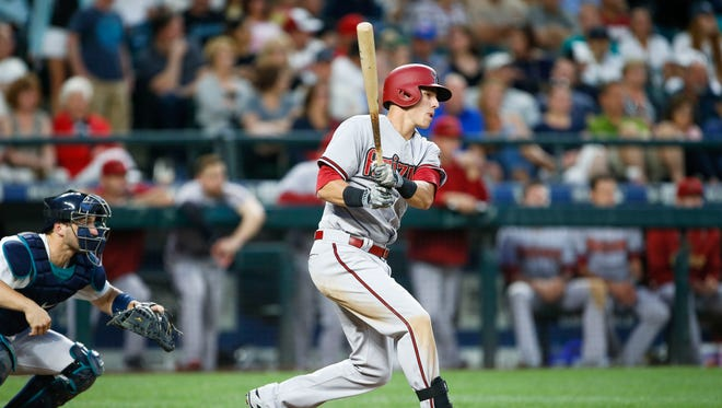 Jul 28, 2015: Arizona Diamondbacks third baseman Jake Lamb (19) singles against the Seattle Mariners during the sixth inning at Safeco Field.