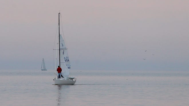 A sailboat and crew makes its way from Lake Ontario into the Genesee River. A coalition that backs a new lake-level plan is mounting a publicity campaign in its favor.