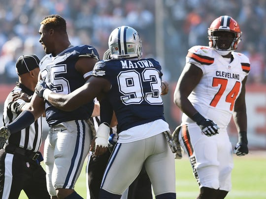 Nov 6, 2016; Cleveland, OH, USA; Dallas Cowboys defensive tackle David Irving (95) and Cleveland Browns center Cameron Erving (74) are separated after fighting during the first quarter at FirstEnergy Stadium. Mandatory Credit: Ken Blaze-USA TODAY Sports