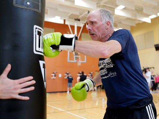 John Reynolds participates in a Rock Steady Boxing class, designed to help individuals with Parkinson's Disease, held June 26, 2018 at Western Racquet & Fitness Club in Ashwaubenon, Wis.