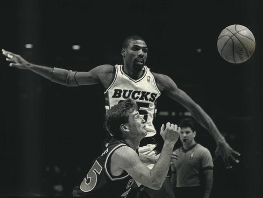 Paul Pressey of the Bucks went high and Mark Price