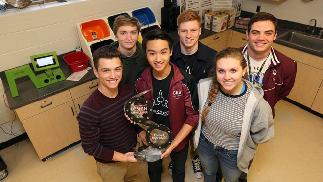Front (left to right)Michael Slemko, 18, Taylor Nguyen, 18, Sophia Friedeborn, 18, (back row left to right) Devlan Horner, 17, Carson Hughes, 19, and Nick Adinolfi, 17, all seniors at Concord High School, won first place in the nation for high school engineering last week for the Scan 'N Sort machine they created to sort bar coded prescription drugs.
