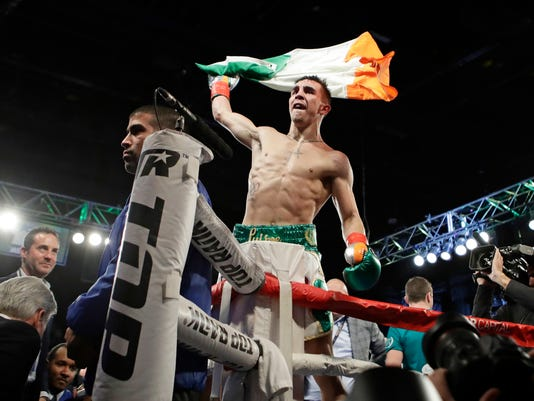 Michael Conlan, of Ireland, celebrates after a super bantamweight boxing match against Tim Ibarra on Friday, March 17, 2017, in New York. Conlan stopped Ibarra in the third round. (AP Photo/Frank Franklin II)