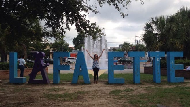 "Newcomer Leslie Wright poses as the ""Y"" in downtown Lafayette!"