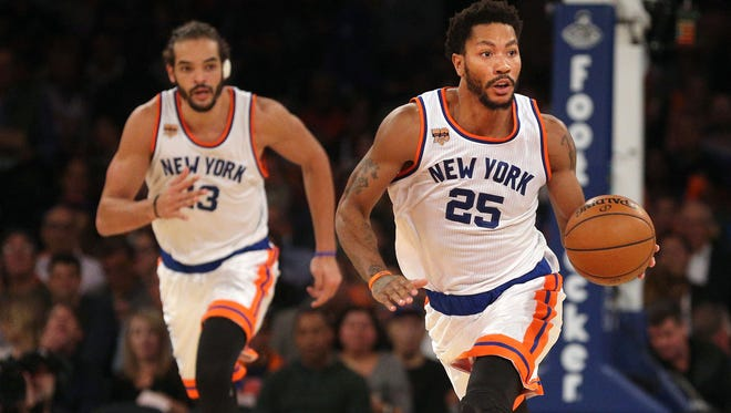 New York Knicks point guard Derrick Rose (25) controls the ball against the Houston Rockets in front of New York Knicks center Joakim Noah (13) during the third quarter at Madison Square Garden.