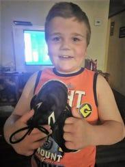 Dreysin Berg, 8, of South Carolina with a pair of shoes