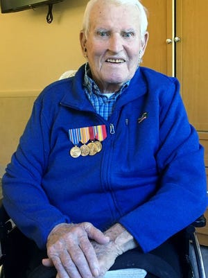 Donal L. Staples Sr. at age 92 with his WWII and Korean War service medals at the Maine Veterans Homes-Scarborough.