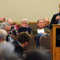 Joy Hohn shares her concerns about a proposed crude oil pipeline running through the Sioux Falls area during a South Dakota Public Utilities Commission hearing Jan. 22, 2015, at the Ramkota Hotel & Conference Center.