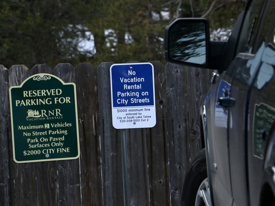 Parking restriction signs are seen at one of RnR Vacation Rentals' properties in South Lake Tahoe on Feb. 20, 2018.