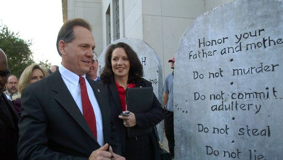 This Nov. 12, 2003 file photo shows Roy Moore looking