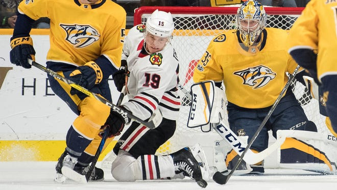 Nashville Predators goalie Pekka Rinne (35) and defenseman Matt Irwin (52) defend against Chicago Blackhawks center Jonathan Toews (19) during the first period at Bridgestone Arena in Nashville, Tenn., Tuesday, Nov. 28, 2017.