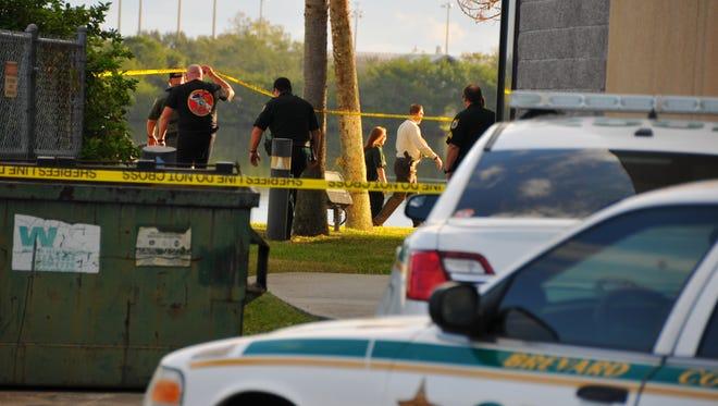 BCSO deputies, investigators and technicians at a crime scene. File photo.