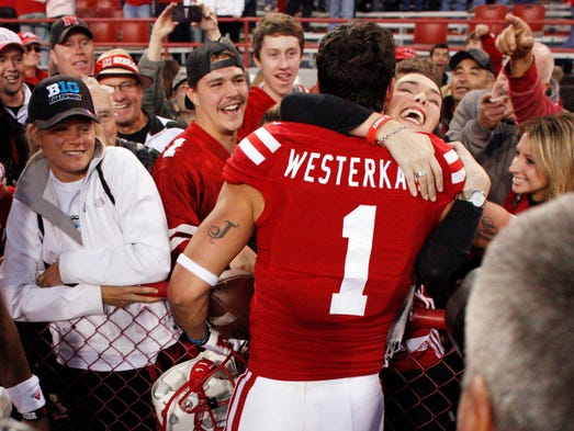 Nebraska Cornhuskers receiver Jordan Westerkamp (1) celebrates with fans after scoring the game-winning touchdown against the Northwestern Wildcats at Memorial Stadium.