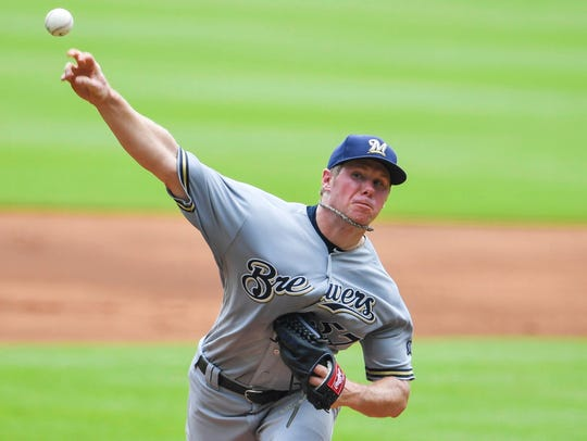 Brewers starting pitcher Chase Anderson works against