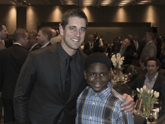 Aaron Rodgers poses for a photo with Thaduba, who has