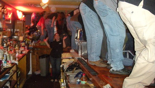 Club-goers dancing on the bar at Blues on Grand. The club closed in 2010.