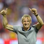 Sep 10, 2013; Columbus, OH, USA; United States head coach Jurgen Klinsmann celebrates a 2-0 win over Mexico at Columbus Crew Stadium. Mandatory Credit: David Richard-USA TODAY Sports
